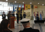 Colonel Jeremy Ramsden, NZ Defense Attaché, is at the podium.  Col. Ramsden was officiating at the commemoration.
